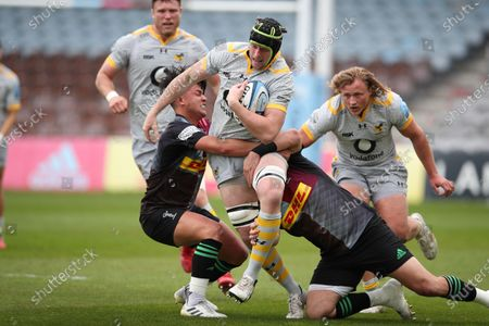 James Gaskell of Wasps is tackled by Marcus Smith (left) and Scott Baldwin of Harlequins