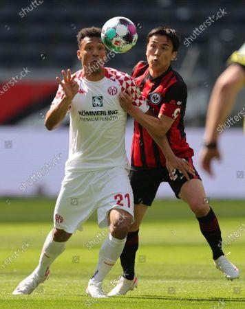 Stock Photo of Mainz's Karim Onisiwo (L) in action against Frankfurt's Makoto Hasebe (R) during the German Bundesliga soccer match between Eintracht Frankfurt and FSV Mainz 05  in Frankfurt, Germany, 09 May 2021.