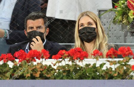 Portuguese former soccer player Luis Figo (L) and his wife, Swedish model Helen Svedin (R), attend the men's final between Alexander Zverev of Germany and Matteo Berrettini of Italy at the Mutua Madrid Open tennis tournament in Madrid, Spain, 09 May 2021.