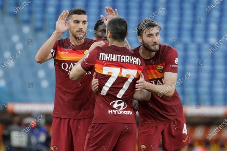 Roma's Henrikh Mkhitaryan, center back to camera, celebrates with his teammates after he scored his side's fourth goal during a Serie A soccer match between Roma and Crotone, at Rome's Olympic Stadium