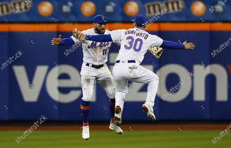 New York Mets Kevin Pillar (11) and Michael Conforto (30) celebrate after defeating the Arizona Diamondbacks 4-2 during a baseball game, in New York