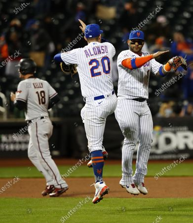 Stock Photo of New York Mets first baseman Pete Alonso (20) and New York Mets second baseman Jonathan Villar (1) celebrate after defeating the Arizona Diamondbacks 4-2 during a baseball game, in New York