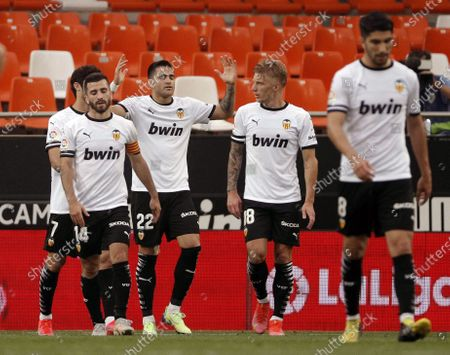 Valencia's Uruguayan striker Maxi Gomez (3-L) celebrates with his teammates after scoring the 1-0 lead during the Spanish LaLiga soccer match between Valencia CF and Real Valladolid at San Mames stadium in Valencia, eastern Spain, 09 May 2021.