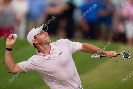 Rory McIlroy throws his ball to the crowd after winning on the 18th hole during the fourth round of the Wells Fargo Championship golf tournament at Quail Hollow, in Charlotte, N.C