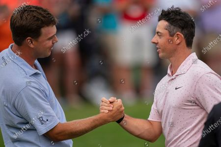 Keith Mitchell, left, congratulates Rory McIlroy on his win in the Wells Fargo Championship golf tournament at Quail Hollow, in Charlotte, N.C