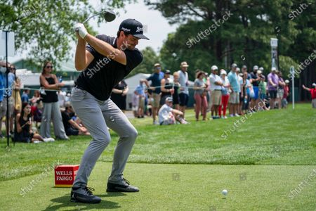 Stock Picture of Keegan Bradley tees off on the 10th hole during the fourth round of the Wells Fargo Championship golf tournament at Quail Hollow, in Charlotte, N.C