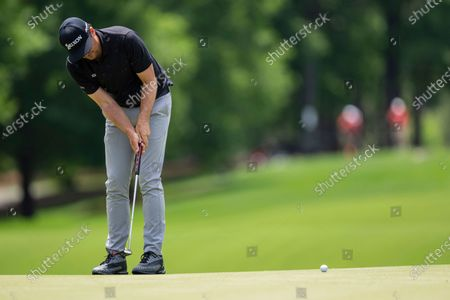 Stock Image of Keegan Bradley putts on the ninth hole during the fourth round of the Wells Fargo Championship golf tournament at Quail Hollow, in Charlotte, N.C