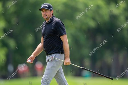 Keegan Bradley walks off the green after finishing on the ninth hole during the fourth round of the Wells Fargo Championship golf tournament at Quail Hollow, in Charlotte, N.C