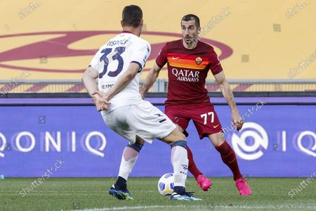 Crotone's Andrea Rispoli (L) and Roma's Henrikh Mkhitaryan in action during the Italian Serie A soccer match AS Roma vs FC Crotone at the Olimpico stadium in Rome, Italy, 09 May 2021.