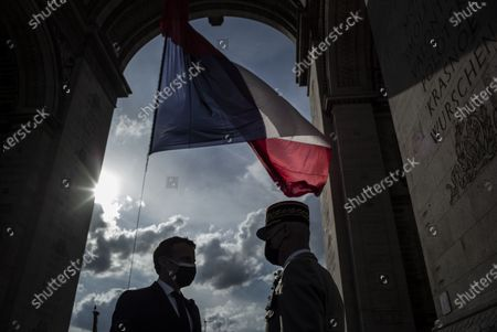 Stock Picture of French President Emmanuel Macron speaks with General Francois Lecointre during a ceremony marking the 76th anniversary of Victory in Europe (Ve-day), marking the end of World War II in Europe, in Paris on May 8, 2021. The leader of the Free French Forces, Charles De Gaulle, announced the official end of World War II to the French people on May 8, 1945, marking the end of a six-year war and the Nazi oppression in France, which resulted in millions of deaths.
