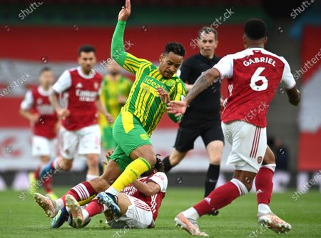 West Bromwich Albion's Matheus Pereira, centre, and Arsenal's Mohamed Elneny challenge for the ball during the English Premier League soccer match between Arsenal and West Bromwich Albion at the Emirates Stadium in London, England