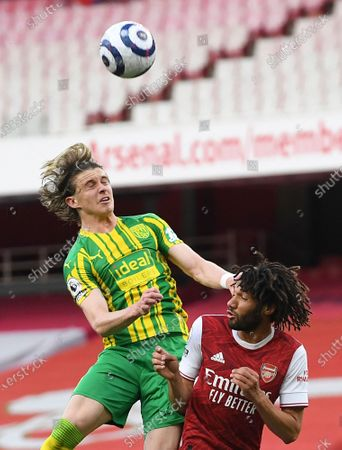 West Bromwich Albion's Conor Gallagher, left, and Arsenal's Mohamed Elneny challenge for the ball during the English Premier League soccer match between Arsenal and West Bromwich Albion at the Emirates Stadium in London, England