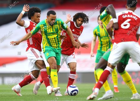 Arsenal's Willian, left, Arsenal's Mohamed Elneny and West Bromwich Albion's Matt Phillips, centre, challenge for the ball during the English Premier League soccer match between Arsenal and West Bromwich Albion at the Emirates Stadium in London, England