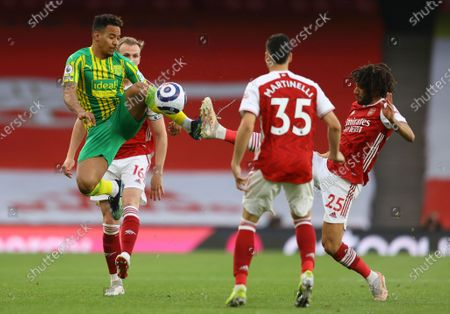 West Bromwich Albion's Matheus Pereira, left, and Arsenal's Mohamed Elneny challenge for the ball during the English Premier League soccer match between Arsenal and West Bromwich Albion at the Emirates Stadium in London, England