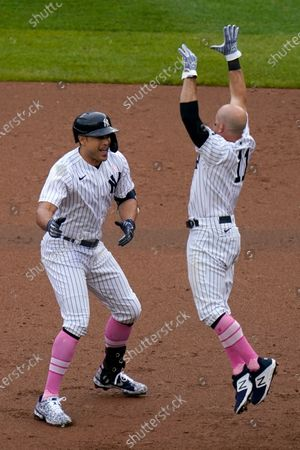 Stock Picture of New York Yankees' Giancarlo Stanton, left, celebrates his walkoff single with Brett Gardner during the ninth inning of a baseball game against the Washington Nationals at Yankee Stadium, in New York