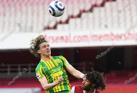 West Bromwich's Conor Gallagher (L) in action against Arsenal's Mohamed Elneny (R) during the English Premier League soccer match between Arsenal FC and West Bromwich Albion in London, Britain, 09 May 2021.