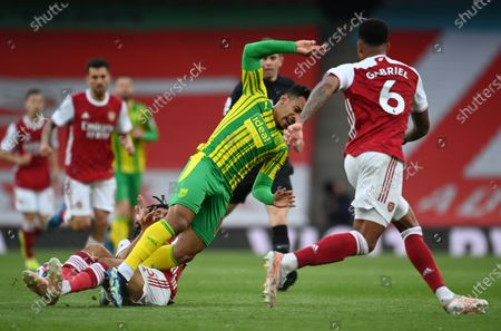 West Bromwich's Matheus Pereira (C) in action against Arsenal's Mohamed Elneny (L) during the English Premier League soccer match between Arsenal FC and West Bromwich Albion in London, Britain, 09 May 2021.