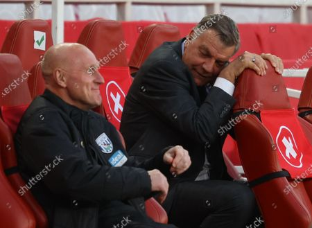 West Bromwich manager Sam Allardyce (R) reacts during the English Premier League soccer match between Arsenal FC and West Bromwich Albion in London, Britain, 09 May 2021.