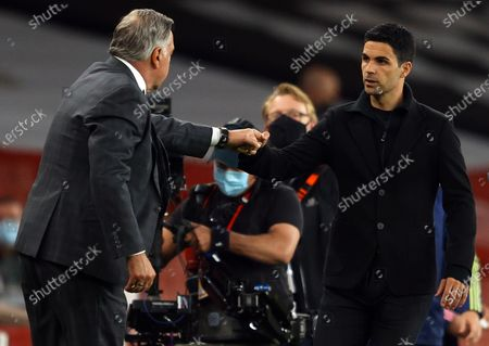 Stock Picture of West Bromwich manager Sam Allardyce (L) and Arsenal's manager Mikel Arteta (R) fist bump after the English Premier League soccer match between Arsenal FC and West Bromwich Albion in London, Britain, 09 May 2021.