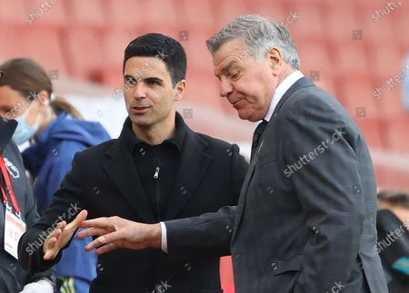 Arsenal's manager Mikel Arteta (L) and West Bromwich manager Sam Allardyce (R) shake hands ahead of the English Premier League soccer match between Arsenal FC and West Bromwich Albion in London, Britain, 09 May 2021.