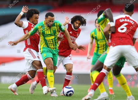 West Bromwich's Matt Phillips (C) in action against Arsenal's Willian (L) and Mohamed Elneny (R) during the English Premier League soccer match between Arsenal FC and West Bromwich Albion in London, Britain, 09 May 2021.