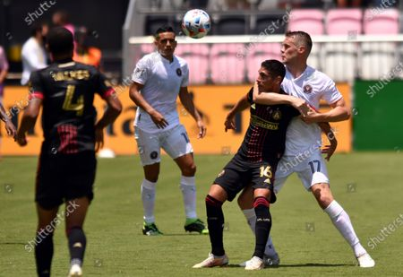Inter Miami defender Ryan Shawcross (17) gets called for a foul as he defends against Atlanta United forward Erik Lopez (16) during the first half of an MLS soccer match, in Fort Lauderdale, Fla
