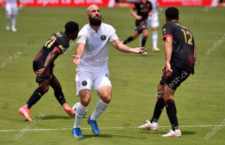 Inter Miami forward Gonzalo Higuain (9) reacts to a pass that was intercepted by Atlanta United defender George Bello (21) during the first half of an MLS soccer match, in Fort Lauderdale, Fla