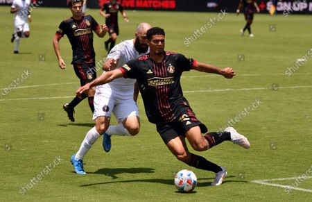 Atlanta United defender Miles Robinson (12) defends against Inter Miami forward Gonzalo Higuain (9) during the first half of an MLS soccer match, in Fort Lauderdale, Fla