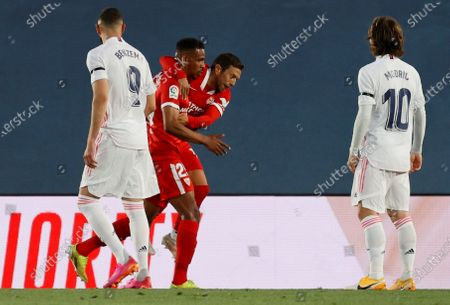 Stock Image of Sevilla's Brazilian midfielder Fernando Reges (2-L) celebrates with his teammates after scoring the 0-1 during the Spanish LaLiga soccer match between Real Madrid and Sevilla FC at Alfredo Di Stefano stadium in Madrid, Spain, 09 May 2021.