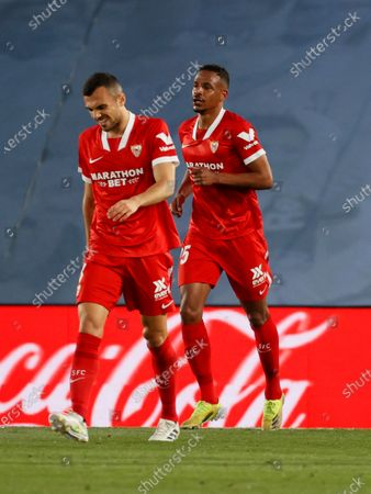 Sevilla's Brazilian midfielder Fernando Reges (R) celebrates after scoring the 0-1 during the Spanish LaLiga soccer match between Real Madrid and Sevilla FC at Alfredo Di Stefano stadium in Madrid, Spain, 09 May 2021.