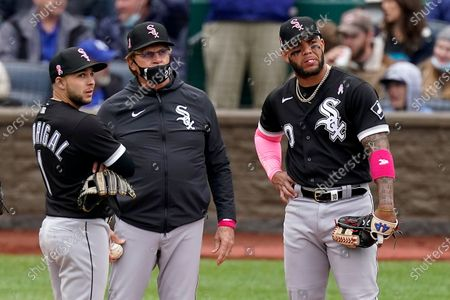 Chicago White Sox manager Tony La Russa, center, stands with Nick Madrigal, left, and Yoan Moncada, right, as he makes a pitching change during the sixth inning of a baseball game against the Kansas City Royals, in Kansas City, Mo