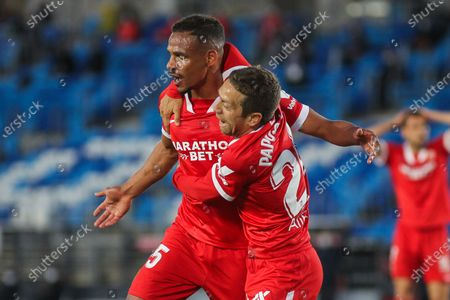 Fernando Francisco Reges of Sevilla celebrates a goal with Papu Gomez during La Liga football match played between Real Madrid CF and Sevilla FC at Alfredo di Stefano stadium on May 09, 2021 in Madrid, Spain.