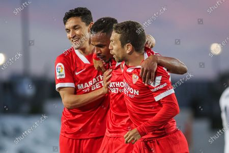 Fernando Francisco Reges of Sevilla celebrates a goal with Jesus Navas and Papu Gomez during La Liga football match played between Real Madrid CF and Sevilla FC at Alfredo di Stefano stadium on May 09, 2021 in Madrid, Spain.