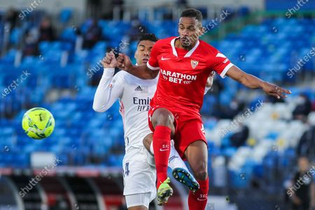 Carlos Henrique Casemiro of Real Madrid and Fernando Francisco Reges of Sevilla fight for the ball during La Liga football match played between Real Madrid CF and Sevilla FC at Alfredo di Stefano stadium on May 09, 2021 in Madrid, Spain.