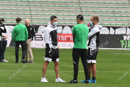 Florian Thauvin and Valere Germain during the French L1 football match between AS Saint-Etienne (ASSE) and Olympique de Marseille (OM) at the Geoffroy Guichard stadium in Saint-Etienne on May 9, 2021.