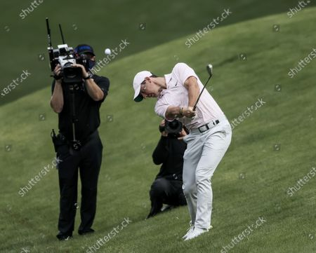 Rory McIlroy of Northern Ireland hits from the rough on the eighteenth hole in the fourth round of the Wells Fargo Championship golf tournament at Quail Hollow Club in Charlotte, North Carolina, USA, 09 May 2021. McIlroy won the tournament with a score of 10 under par.