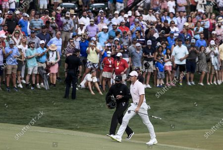 Rory McIlroy of Northern Ireland walks onto the eighteenth green in the fourth round of the Wells Fargo Championship golf tournament at Quail Hollow Club in Charlotte, North Carolina, USA, 09 May 2021. McIlroy won the tournament with a score of 10 under par.