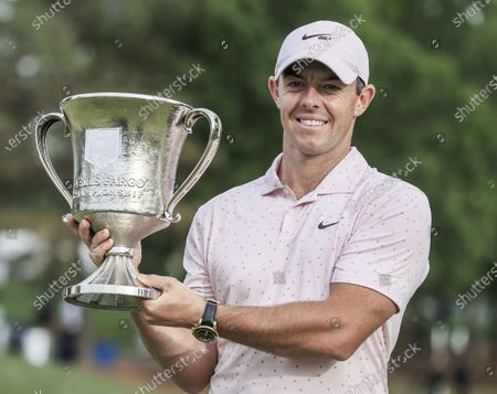 Rory McIlroy of Northern Ireland poses with the winners trophy after the fourth round of the Wells Fargo Championship golf tournament at Quail Hollow Club in Charlotte, North Carolina, USA, 09 May 2021. McIlroy won the tournament with a score of 10 under par.