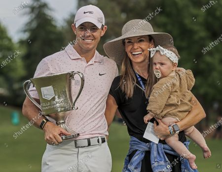Rory McIlroy of Northern Ireland (L) poses with the winner's trophy and his wife Erica Stoll (C) and daughter Poppy after winning the Wells Fargo Championship golf tournament at Quail Hollow Club in Charlotte, North Carolina, USA, 09 May 2021. McIlroy won the tournament with a score of 10 under par.