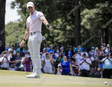 Rory McIlroy of Northern Ireland reacts to his putt on the fifth green during the fourth round of the Wells Fargo Championship golf tournament at Quail Hollow Club in Charlotte, North Carolina, USA, 09 May 2021.