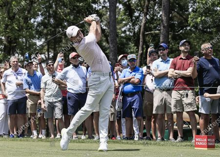 Rory McIlroy of Northern Ireland hits his tee shot on the fifth hole during the fourth round of the Wells Fargo Championship golf tournament at Quail Hollow Club in Charlotte, North Carolina, USA, 09 May 2021.