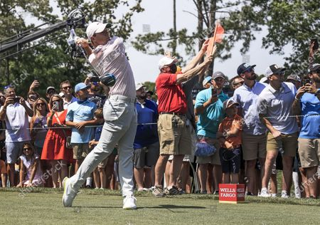 Rory McIlroy of Northern Ireland hits his tee shot on the eighth hole during the fourth round of the Wells Fargo Championship golf tournament at Quail Hollow Club in Charlotte, North Carolina, USA, 09 May 2021.