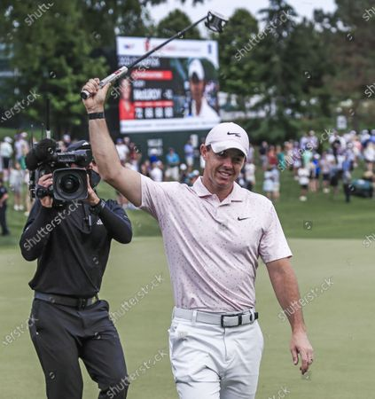 Rory McIlroy of Northern Ireland raises his putter as he walks off the eighteenth green after winning the Wells Fargo Championship golf tournament at Quail Hollow Club in Charlotte, North Carolina, USA, 09 May 2021.