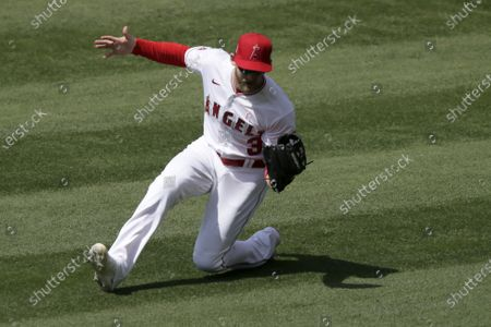 Los Angeles Angels right fielder Taylor Ward makes a sliding catch on a fly ball hit by Los Angeles Dodgers' Will Smith during the fifth inning of a baseball game in Anaheim, Calif