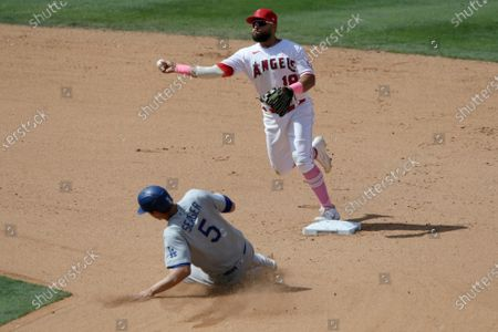 Los Angeles Angels second baseman Jose Rojas throws to first over Los Angeles Dodgers' Corey Seager for a double play on Will Smith during the seventh inning of a baseball game in Anaheim, Calif