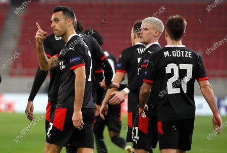 PSV's Eran Zahavi, left, reacts after scoring his second goal during a Europa League, round of 32, first leg soccer match, between Olympiacos and PVS at Georgios Karaiskakis stadium in Piraeus port, near Athens