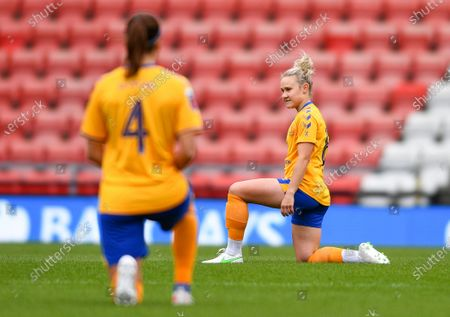 Izzy Christiansen (C) (8 Everton) takes a knee in support of the Black Lives Matter movement