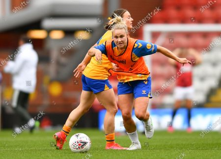 Stock Image of Izzy Christiansen (C) (8 Everton) warms up