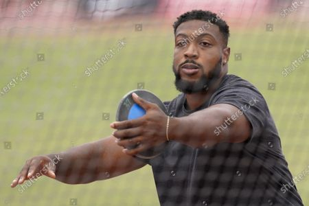 Stock Photo of Reggie Jagers III competes in men's discus throw during the USATF Golden Games at Mt. San Antonio College, in Walnut, Calif. He finished first