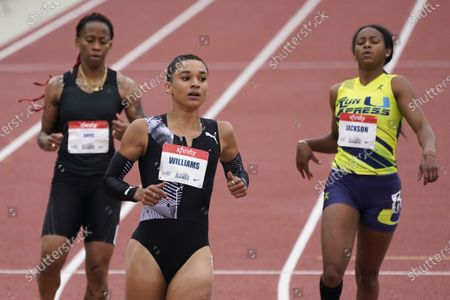 Jodie Williams, center, wins the women's 200 meter dash B race during the USATF Golden Games at Mt. San Antonio College, in Walnut, Calif. Michelle Lee Ahye is at left and Shawnti Jackson is at right